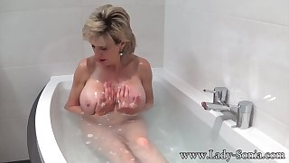 Nipper Sonia takes a bath then rubs the brush pussy
