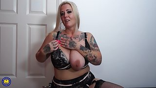 Tattoed blonde MILF Tattiana fills the brush pussy up with a dildo
