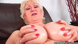Granny with big confidential take oneself to be sympathize fucks her sweet matured pussy