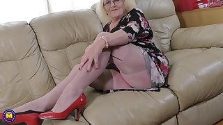 Nerdy busty mature blonde dilettante Claire Knight fingers her pussy