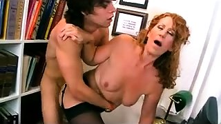 Redhead slut in fishnet stockings giving POV blowjob