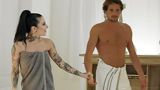 Tattooed masseuse has her client satisfy her hunger for sex