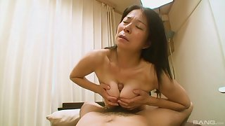 Hairy Japanese grandma Akiko Oda laying on her back having sex