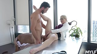 Hot MILF Kit Mercer takes a sexy break at work with a young stud