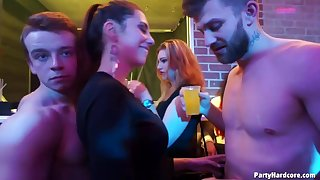 A group of naughty girls is having tons of fun in the night club, with handsome guys